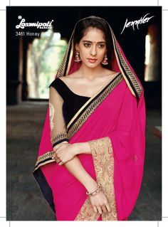 You rule! Is the only compliment every woman would get worn this sensational deep pink saree with one side net jari diamond border and another side , velvet sequence jari lace. The plain velvet blue blouse with net embroidery sleeves is included with the saree.