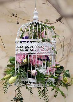 Beautiful birdcage with flowers. Would be great in a neutral bedroom to add color.
