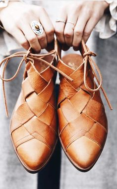 Gorgeous woven leather flats shoes with closed toes, ties at the ankles, and open back. Perfect for spring!