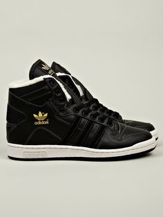 sports shoes d06b1 babe7 The adidas Originals Mens Decade OG Mid Fleece Lined Sneaker, seen here in  black.