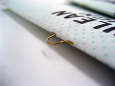 Using brass wire loops instead of flat steel wire to bind a booklet - http://s.coop/xw2g