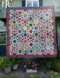 This quilt has continuity in the color of the triangles surrounding each hexagon, otherwise apparently random.