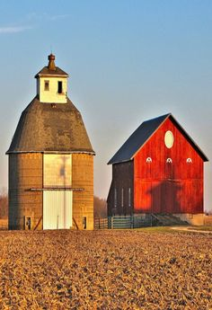 The silo, used for grain storage looks nearly as big as the barn.