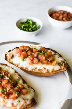Ready in only 15 minutes, this Molletes recipe is made with all the Mexican staples - bolillo bread rolls, refried beans and cheese! Top it with a little pico de gallo or your favorite salsa and enjoy for breakfast, lunch or dinner any day of the week. This recipe is also vegetarian. Mexican Dishes, Mexican Food Recipes, Snack Recipes, Ethnic Recipes, Snacks, Easy Recipes, Molletes Recipe, Homemade Refried Beans, Roasted Tomato Salsa