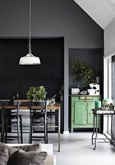 Love this black wall and white floor and green to add some nature