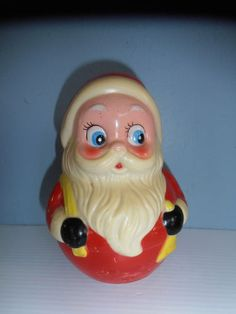 1960's hard plastic Roly Poly Santa Claus with bell inside, I think probably made in Hong Kong.  In 1999, I bought at a yard sale for 50 cents and was thrilled!!   LOL