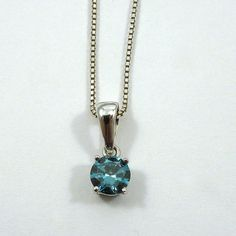 0.75 Carat Treated Blue Diamond with SI2 Clarity set in a White Gold Pendant. Sold on a Sterling Silver Chain. $800