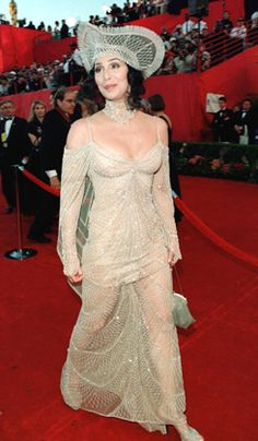 Ha ha ha.  Gorgeous Cher with her beautiful face, hair and figure always seems to end up with the ugliest, most tasteless dresses.