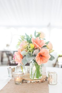 Pink amaryllises in a mason jar | Brides.com
