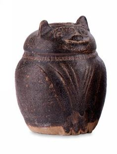 CAMBODIA or THAILAND  Cambodia or Thailand Lime pot, in the form of a smiling cat 12th century, Cambodia or northeast Thailand stoneware, brown glaze 12.0 cm (height) Chinese Exhibition Fund and South Australian Government Grant 1978 Art Gallery of South Australia, Adelaide 783C25