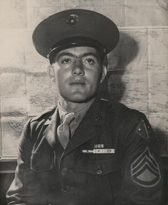 """""""Marine Congressional Medal of Honor Hero Platoon Sergeant John Basilone, USMC, recently visited the Marine Headquarters at Washington, DC.  Pl. Sgt. Basilone's home is Raritan, NJ.  He was awarded the Congressional Medal of Honor for """"extraordinary heroism and conspicuous gallantry in action above and beyond the call of duty.""""""""    From the Carolyn Orehovic Collection (COLL/5425), Marine Corps Archives & Special Collections  OFFICIAL USMC PHOTOGRAPH"""