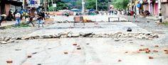 Road blocked by protesters at Dooru Anantnag on Wednesday.  Excelsior/Sajad Dar