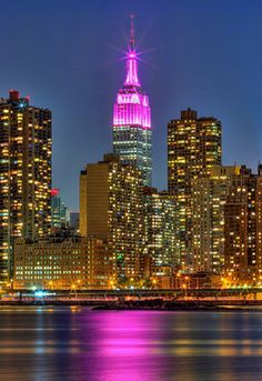 The Empire State Goes Pretty in Pink - The Empire State Building in New York City gets a pink makeover in honor of Breast Awareness Month, casting the Hudson River in a lovely pink glow.