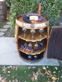 Wine barrel wine/glass holder. $375.00, via Etsy.