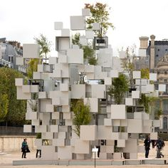 Japanese architect Sou Fujimoto has created an installation in Paris' Jardins des Tuileries composed of suspended metal cubes and plants, for the FIAC art fair.