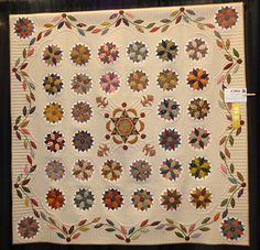 """Elizabeth Poole made """"Under the Southern Stars"""". She said in her write-up that it was her first attempt at English paper piecing. She used Susan Daly's Pattern called Patchwork with Busy Fingers. The quilting was done by Eileen McCabe"""