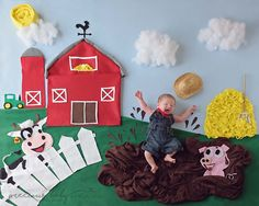 Adorable photo of newborn baby boy farmer splashing in the mud. Barn cow pig baby scene unique cute funny hilarious Baby ImaginArt by Angela Forker Precious Baby Photography Fort Wayne New Haven Indiana