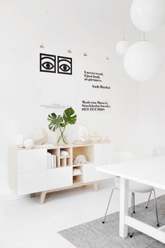 No 216 sideboard from Voioce, white and wood with a pop of green.