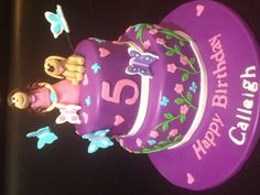 Purple fondant birthday cake with butterflies, little girl and her dog. For a little girls 5th birthday.