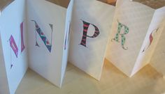 Letters in an accordion fold.