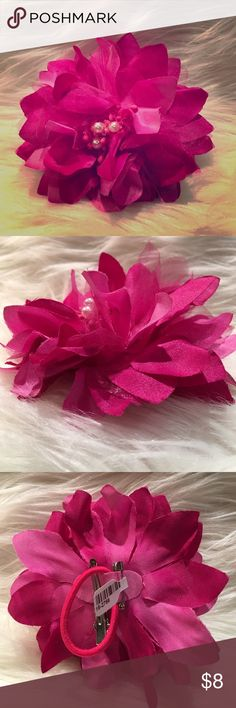"Fuscia Flower pin, clip or hair accessory, Brand new with tags. Can be pinned, clipped or elastic hair band to wear as a pony tail. Approx 4.25 in diameter and 2"" of fluffy. Accessories Hair Accessories"