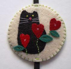 Marcador elástico gatos e corações
