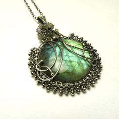 Reserved  -  Silver wire wrapped pendant with labradorite, green, woodland, wirework. $50.00, via Etsy.