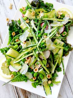 Spring Salad w/Lemon Herb Vinaigrette (zucchini ribbons red leaf lettuce sliced radishes shaved asparagus spears peas fava beans hazelnuts lemon wedges and Parmesan shavings for garnish) Zucchini Salad, Asparagus Salad, Asparagus Recipe, Asparagus Spears, Kale Salads, Broccoli Salad, Arugula Salad, Quinoa Salad, Fruit Salad