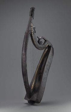 Harp (cláirseach)1734 John Kelly, Irish, active 1726–1736 Ireland. Height 167.8 cm, width 78.6 cm, depth 33.4 cm (Height 66 1/16 in., width 30 15/16 in., depth 13 1/8 in.)  Willow, brass  Inscriptions: Incised on pillar: MADE - BY / IOHN - KELLY / FOR / THE REVD / CHARLES / BUNWORTH / BALTDANI / EL / 1734    Museum of Fine Arts, Boston MA USA