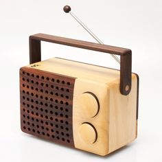 Found at Poketo.com -Traditional craft meets retro modern design. This wooden radio and MP3 player, designed by Singgih Kartono, is hand-crafted in a farming village in Indonesia from new-growth wood. For each tree that is used in the production of the radios, a new tree is planted.