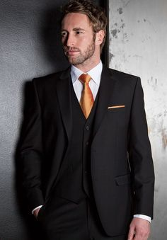 Black Three Piece Tailored Fit suit with burnt orange tie and pocket square, ideal for Autumn Weddings // Slaters Formal Wedding Hire Suits Collection