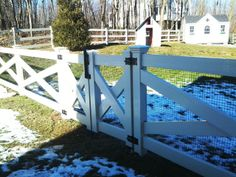 Cross-Buck Vinyl Post and Rail Fence with gate.  would have to be super sized for the driveway