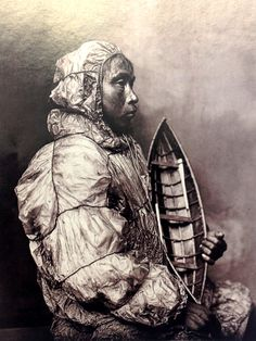 An Alaskan Eskimo man in 1900s models a parka fashioned of walrus intestine. Waterproof and easy to come by for the sea-focused people, the material was prepared by air curing, sliced and sewn with a waterproof stitch, the same used on the umiak (canoe) he's holding. The jacket's extra material at the hem functioned as a spray skirt when he was at sea. Other innards with uses: Bladders became water bags, guts got sewn together as sod-house windows, and stomachs stretched for tambourine drums