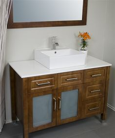 45 inch bathroom vanity made from solid wood.  Stylish sink sits on top. Comes with a mirror and faucet.