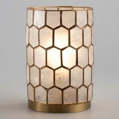 Artisans in the Philippines harvest natural capiz shells and cut them expertly by hand to create our honeycomb lamp. Turn it on to illuminate each translucent seashell in the gold-finished frame and fill your desk or tabletop with a warm, ambient glow. Unique Table Lamps, Gold Office, Novelty Lighting, Curtains With Rings, Boho Living Room, Rustic Lighting, Bedroom Lamps, World Market, Tabletop