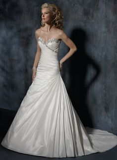 I would probably Love any Maggie Sottero dress I could possibly try on.. Stunning!