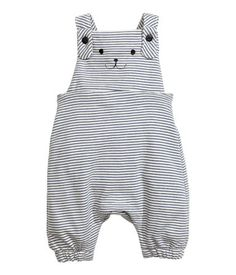 Natural white/blue stripe. Bib overalls in soft, lightweight sweatshirt fabric with a printed motif on bib. Suspenders crossed at back, elastication at back