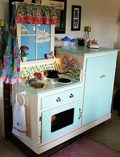 used to be an entertainment center but now a childrens play kitchen. this is something that I will have to make for my kids someday.