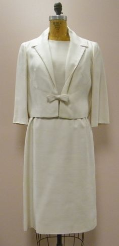 This is an absolutely STUNNING vintage suit! This is a 2-pc dress with removable matching jacket, under dress is a sleeveless shift. This is a