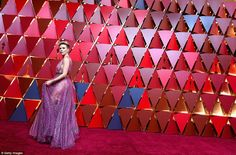 Purple reign: Scarlett poses against one very Instagrammable backdrop...
