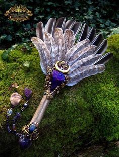GOLDEN OAKWING. Turkey Feather Smudge Fan. Peacock Ore, Amethyst, Labradorite. Ice Age Bison Metacarpal fossil handle. Amethyst Quartz cluster and Druzy Quartz beaded dangles. Private Collection. Lovingly handmade in The Secret Lair by Susan Tooker