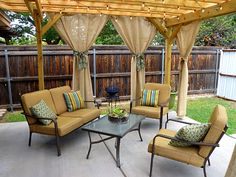 Pergola & curtains = outdoor privacy, shade, and style