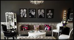 I like the pictures hanging on the back wall..and. the splashes of color against the black and white.