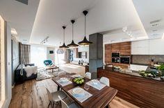 Nowoczesne wnętrza salonu z kuchnią i jadalnią