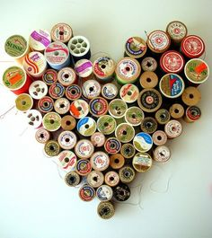Sewing spool art - how cool would that look on a wall!