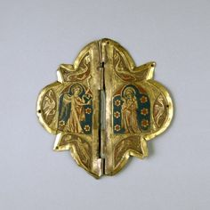 """ca 1325 Clasp with Annunciation Scene (champleve enamel on copper). French. """"During the Middle Ages, copper mantle clasps with enameled decoration and gemstones were primarily made for church garments. This clasp is decorated with the Annunciation scene, showing the Virgin and Gabriel surrounded by six dragons. This piece surely belonged to an ecclesiastical vestment."""" -Walters Museum"""