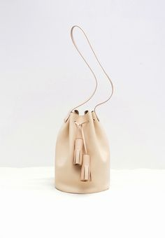 8ea1c79c4 a classic bucket bag 32 × 30 × 21 cm, strap drop 43 cm Smooth nude colored  leather, Leather shoulder strap, Leather tassels, Leather lined base
