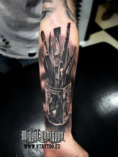 Tattoo of an Artists paintbrushes