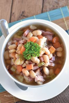 Delicious Ham and Bean Crockpot Soup! It's goes together in a snap and will have the whole family asking for seconds!
