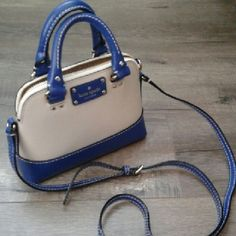 Kate Spade shoulder bag NWT Kate Spade shoulder bag. Cream and blue colors looks fantastic. The liner is cream and has two card slots. Small handles are cute. This purse can be shoulder or cross body. kate spade Bags Shoulder Bags